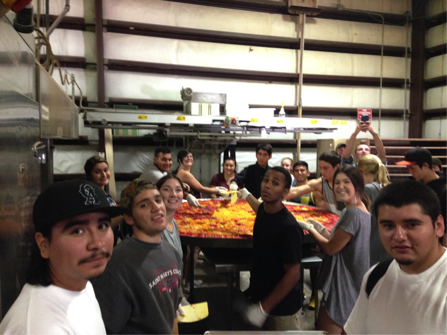 Vineyard Academy students making a 7-foot Pizza at Costeaux Bakery.